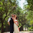 European bride and groom kissing in the park — Stock Photo #52890775