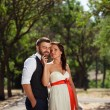 European bride and groom kissing in the park — Stock Photo #52890807