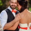 European bride and groom kissing in the park — Stock Photo #52969223
