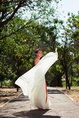 European bride dancing in the park — Stock Photo