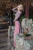 Beautiful blonde in dress walks in autumn — Stock Photo