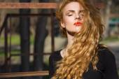 Beautiful fashion model with red hair — Stock Photo