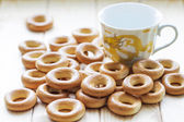 Dry bread-rings with a cup — Stock Photo