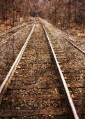 Textured image of railroad tracks — Stock Photo