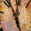 Rusty, rough clock face showing midnight — Stock Photo #63340431