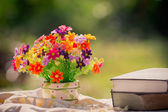 Bouquet of flowers and book in nature background — 图库照片