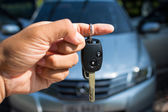 Car key in hand — Stock Photo