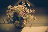 Beautiful artificial flower with retro filter effect — Stock Photo
