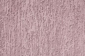 Violet relief plaster on wall closeup — Stock Photo