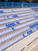 Rows of  light and dark  blue plastic stadium seats — Foto de Stock