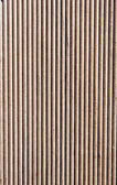 Wooden brown grooves panel closeup — Stock Photo