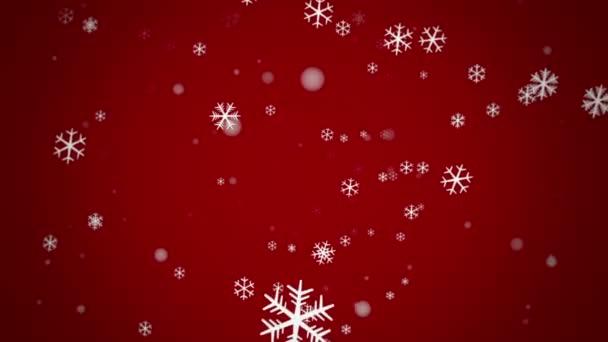 Copos de nieve delante de un fondo rojo - lazo — Vídeo de stock