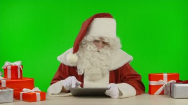 Santa Claus Finding a Special Christmas Offer on His Tablet — Stock Video