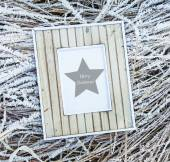 Old wooden frame over frozen grass. Merry Christmas — Stok fotoğraf