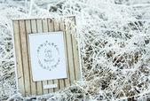 Wooden frame over frozen grass — Foto de Stock
