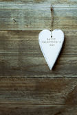 White heart hanging over wood — Foto de Stock