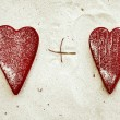 Red heart on the sandy beach — Stock Photo #63317841