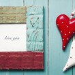 Two wooden hearts with picture frame LOVE YOU — Stock Photo #63341293