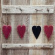 Three red and one black chalk heart — Stock Photo #63342705