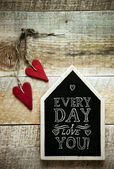 House shaped chalk board and two red vintage hearts — Stock Photo