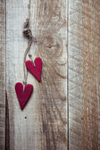 Two painted red hearts — Stock Photo