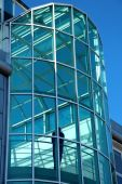 Modern glass building with a silhouette insid — Stock Photo