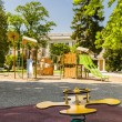 Yellow game for childrens in a park — Stock Photo #73679269