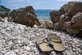 Flip-flops on the Croatian stone beach  — Stock Photo
