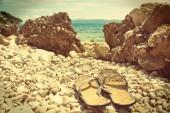 Flip-flops on the Croatian stone beach - vintage version — Stock Photo