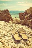 Flip-flops on the Croatian stone beach — Stock Photo