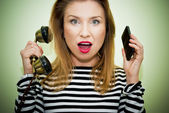 Busy woman on hot line — Stock Photo