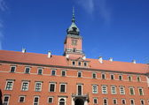 Warsaw royal palace and clock tower in Poland — Stock Photo
