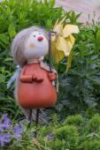 Plaster sculptures of assistants in a garden — Stock Photo