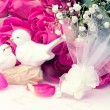 Figurines wedding doves in love Valentine bouquet of pink roses on old books floral background is love tenderness vintage retro selective soft focus — Stock Photo #74238223