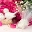 Figurines wedding doves in love Valentine bouquet of pink roses on old books floral background is love tenderness vintage retro selective soft focus — Stock Photo #74238307