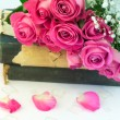 Bouquet of pink roses on old books floral background is love tenderness vintage retro selective soft focus — Stock Photo #74239717