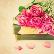 Bouquet of pink roses on old books floral background is love tenderness vintage retro selective soft focus — Stock Photo #74239813