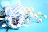 Gentle blue the background fabric heart Lily of the valley selective soft focus toned photo love tree Valentine — Stock Photo