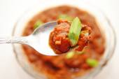 Spoonful of Appetizing Chili with Green Onion — Stock Photo