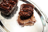 Eating a Triple Chocolate Brownie on a Silver Platter — Stock Photo