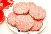 Fresh Raw Hamburgers Made with a Hamburger Press — Stock Photo
