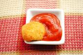 A Chicken or Fish Baked Nugget in Catsup — Stock Photo
