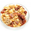 Fruit and Nut Trail Mix in a Glass Bowl — Stock Photo #55061331