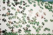 Building a Puzzle That is Laid Out on a Table — Stock Photo