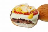 Juicy Cheese Burger with Onion, Mustard, and Catsup — Stock Photo