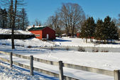 A Snowy Barn on a Farm with a Wooden Fence — Stock Photo