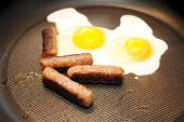 Cooking Two Sunny Side Up Eggs with Sausage — Stock Photo