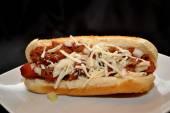 Cheesy Chili Dog on a White Plate — Stock Photo