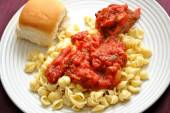 Shell Pasta with a Meatball and Dinner Roll — Stock Photo