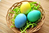 3 Easter Eggs in a Basket — Stock Photo